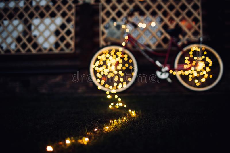 Christmas lights on bike background texture in city stock photo
