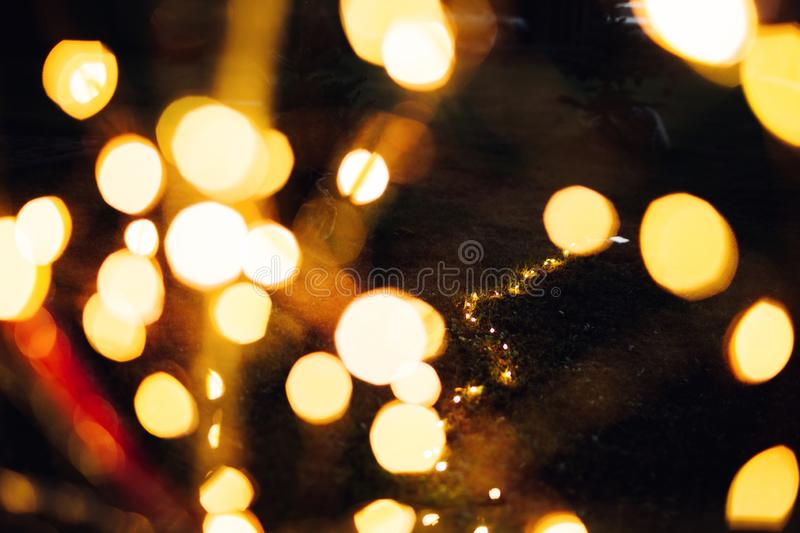 Christmas lights on bike background texture in city stock image