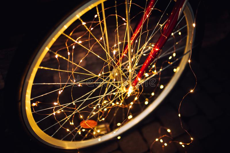 Christmas lights on bike background texture in city stock photography