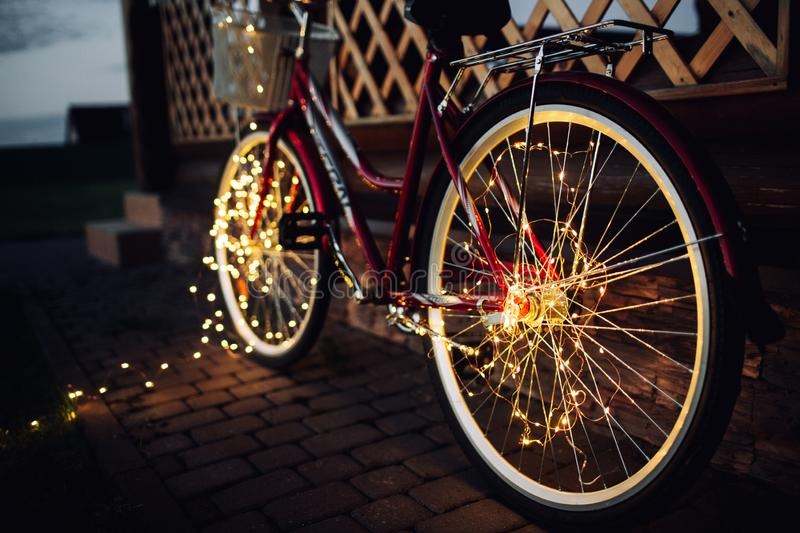 Christmas lights on bike background texture in city stock photos