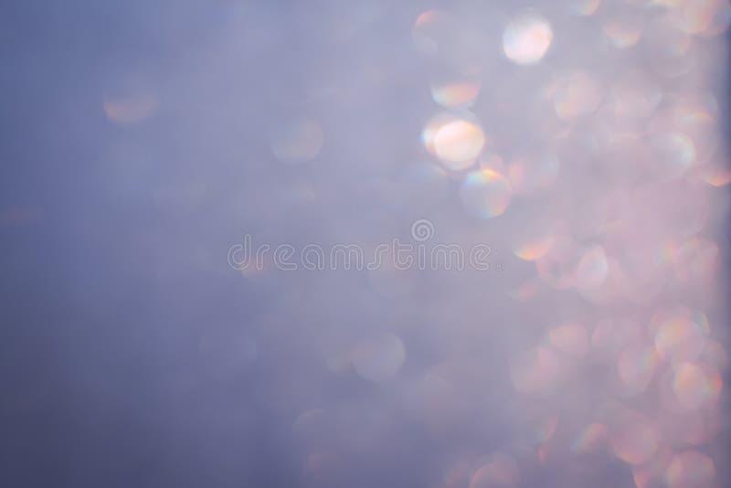Christmas lights bokeh background pastel pink, silver specks royalty free stock photo