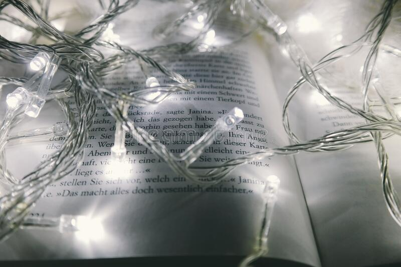 Christmas lights on book stock photo