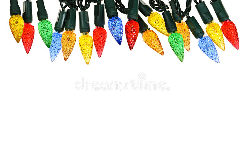 Christmas lights border. Multicolored string of Christmas lights isolated on white background