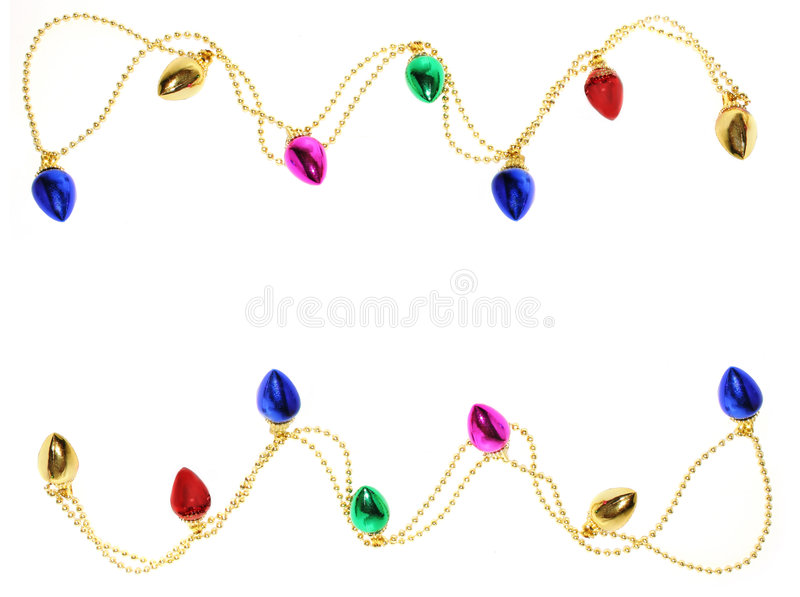 Christmas Lights Border. A garland of christmas lights on gold beads form top and bottom border on white background stock photography