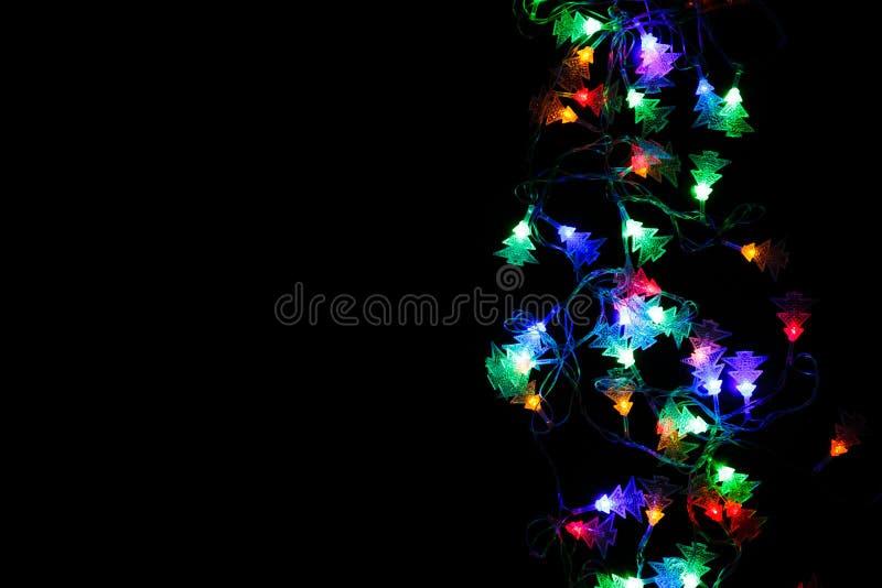 Christmas lights border on black background stock photo