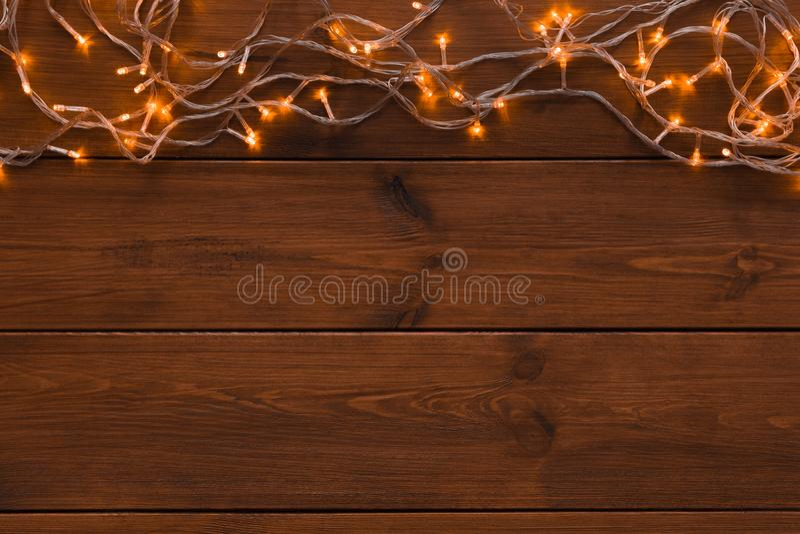 Download Christmas Lights Border On Wood Background Stock Image