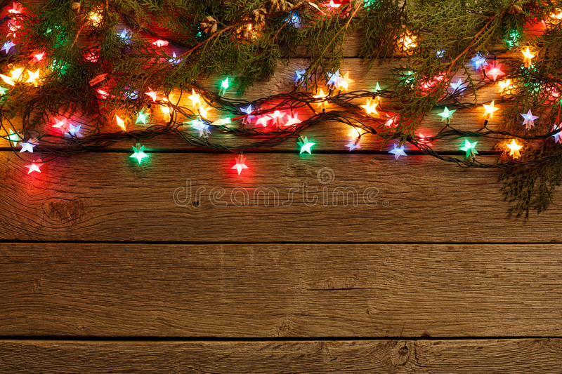 Download Christmas Lights Border On Wood Background Stock Photo