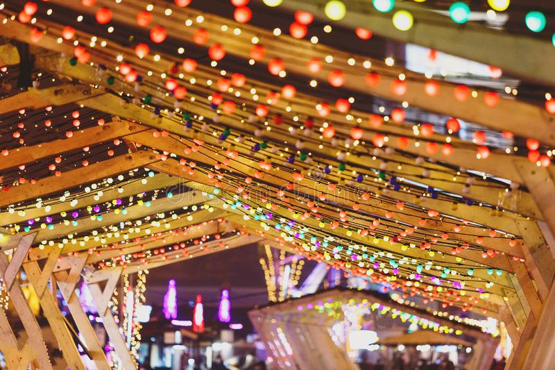 Christmas lights and bulb garlands on the city streets. New year and Christmas decoration. In the town stock photography