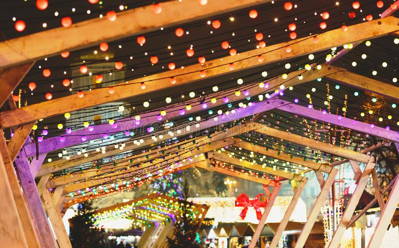 Christmas lights and bulb garlands on the city streets. New year and Christmas decoration. In the town stock photo