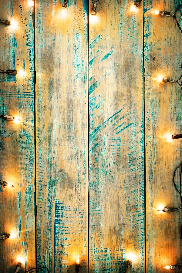 Christmas lights bulb on wood table. Merry christmas xmas background. topview, border design - rustic and vintage styles royalty free stock photos