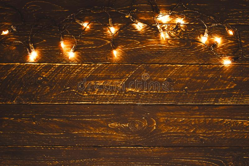 Christmas lights bulb on wood table. Merry christmas xmas background. Topview, border design - rustic and vintage styles stock images