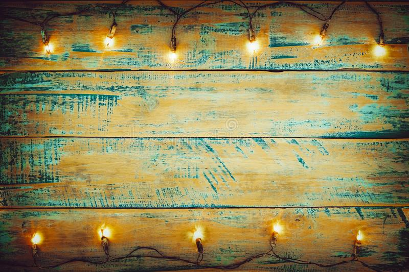 Christmas lights bulb on wood table. Merry christmas xmas background. Topview, border design - rustic and vintage styles stock photos