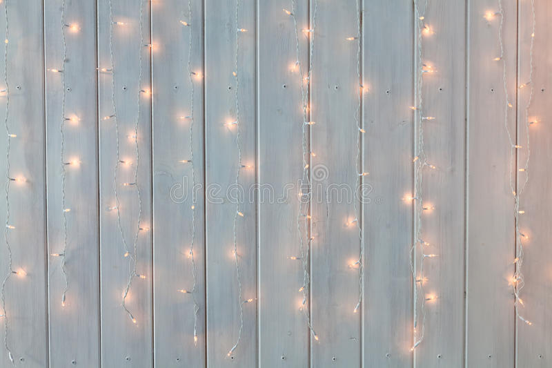 Download Christmas Lights Burning On A White Wooden Background. New Year Back. Stock Image - Image of holiday, fashioned: 80636953