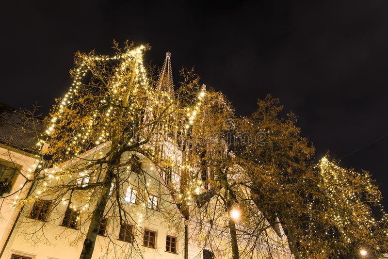 Christmas lights at the cathedral in Regensburg, Germany.  stock photo