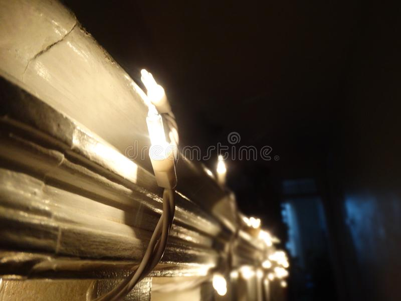 Christmas lights. Wrapped around a banister royalty free stock photo