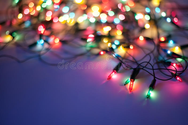 Christmas lights on dark blue background. With copy space. Decorative garland