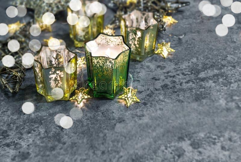 Christmas lights decoration Burning candles shiny stars vintage stock image