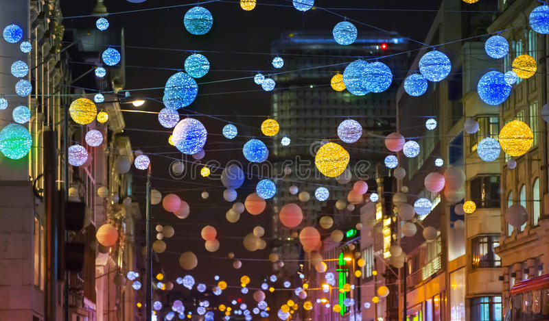 Christmas lights decoration at Oxford street and lots of people. LONDON, UK - DECEMBER 30, 2015: Christmas lights decoration at Oxford street during the royalty free stock images