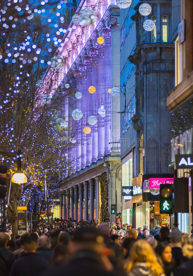Christmas lights decoration at Oxford street and lots of people. LONDON, UK - DECEMBER 30, 2015: Christmas lights decoration at Oxford street and lots of people stock photo