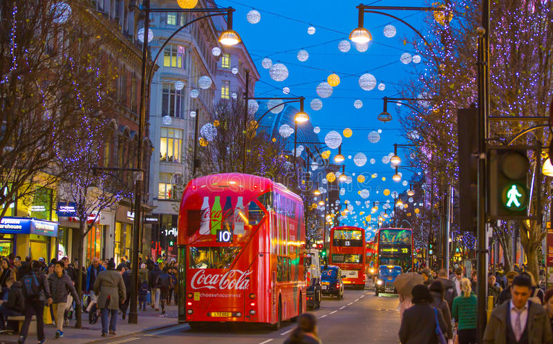 Christmas lights decoration at Oxford street and lots of people. LONDON, UK - DECEMBER 30, 2015: Christmas lights decoration at Oxford street and lots of people stock photos