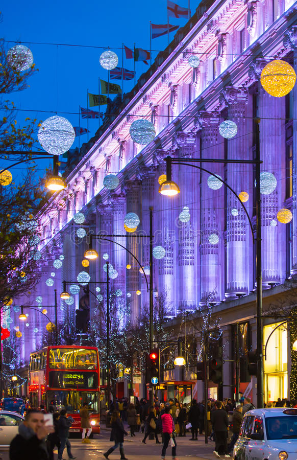Christmas lights decoration at Oxford street and lots of people. LONDON, UK - DECEMBER 30, 2015: Christmas lights decoration at Oxford street and lots of people stock image
