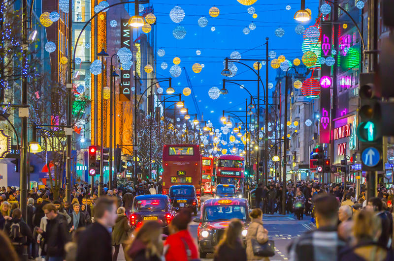 Christmas lights decoration at Oxford street and lots of people. LONDON, UK - DECEMBER 30, 2015: Christmas lights decoration at Oxford street and lots of people royalty free stock images