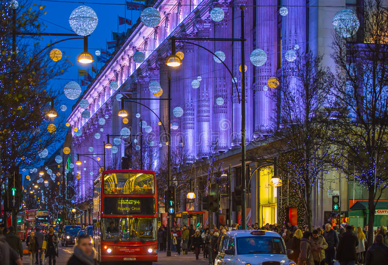 Christmas lights decoration at Oxford street and lots of people. LONDON, UK - DECEMBER 30, 2015: Christmas lights decoration at Oxford street and lots of people stock photography