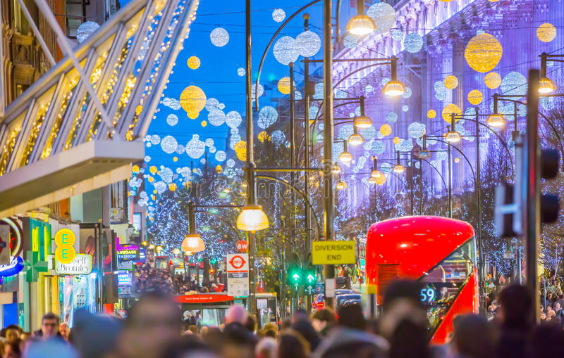Christmas lights decoration at Oxford street and lots of people. LONDON, UK - DECEMBER 30, 2015: Christmas lights decoration at Oxford street and lots of people royalty free stock photo
