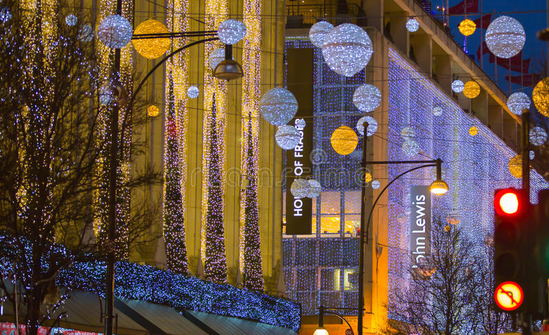 Christmas lights decoration at Oxford street and lots of people. LONDON, UK - DECEMBER 30, 2015: Christmas lights decoration at Oxford street and lots of people stock images