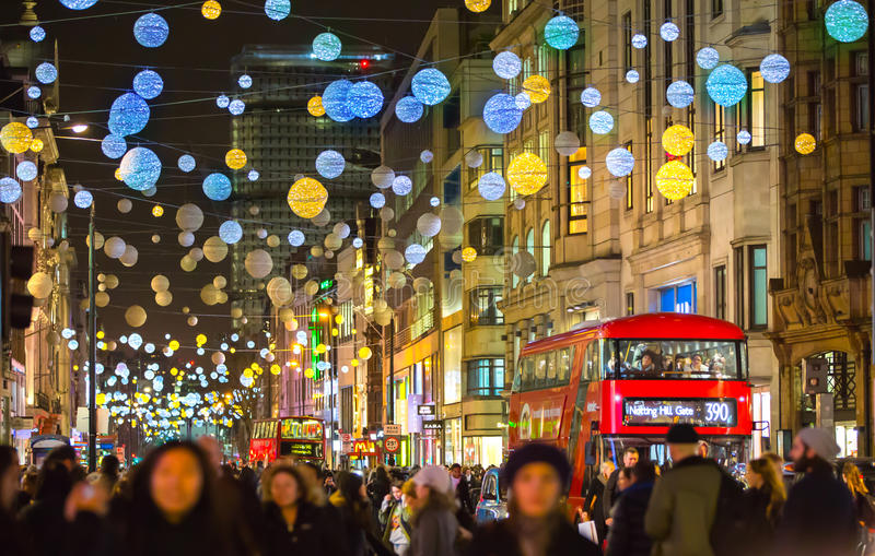 Christmas lights decoration at Oxford street and lots of people. LONDON, UK - DECEMBER 30, 2015: Christmas lights decoration at Oxford street and lots of people royalty free stock photography
