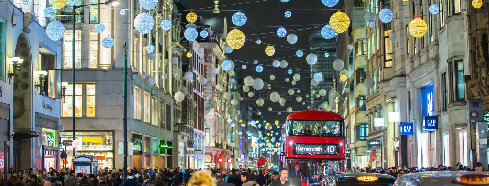 Christmas lights decoration at Oxford street and lots of people. LONDON, UK - DECEMBER 30, 2015: Christmas lights decoration at Oxford street and lots of people royalty free stock photos