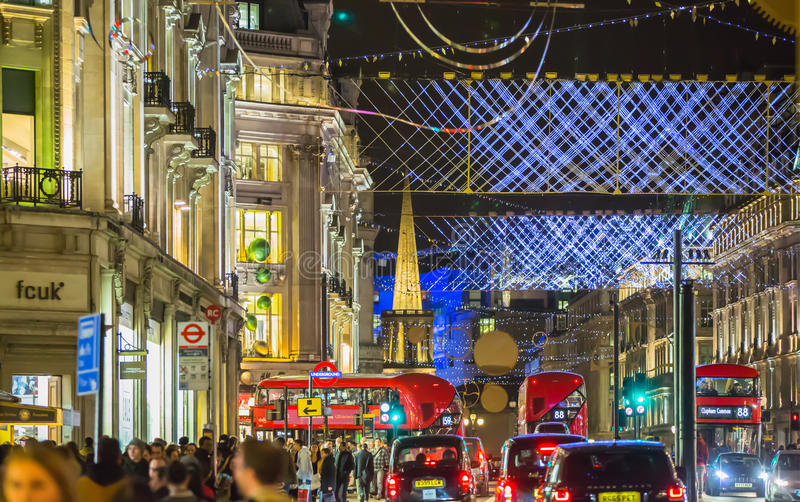 Christmas lights decoration at Regent street and lots of people. London. LONDON, UK - DECEMBER 30, 2015: Christmas lights decoration at Regent street and lots of stock photo