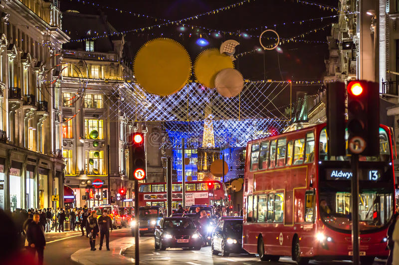Christmas lights decoration at Regent street and lots of people. London. LONDON, UK - DECEMBER 30, 2015: Christmas lights decoration at Regent street and lots of royalty free stock images