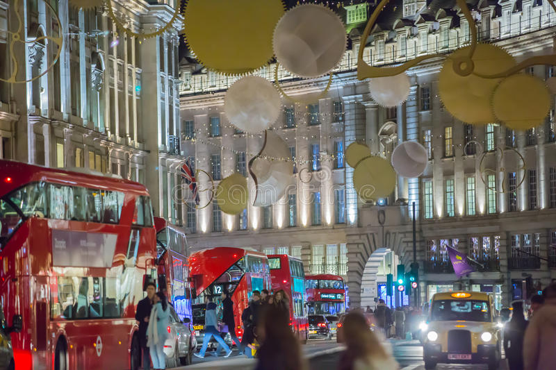 Christmas lights decoration at Regent street and lots of people. London. LONDON, UK - DECEMBER 30, 2015: Christmas lights decoration at Regent street and lots of royalty free stock image