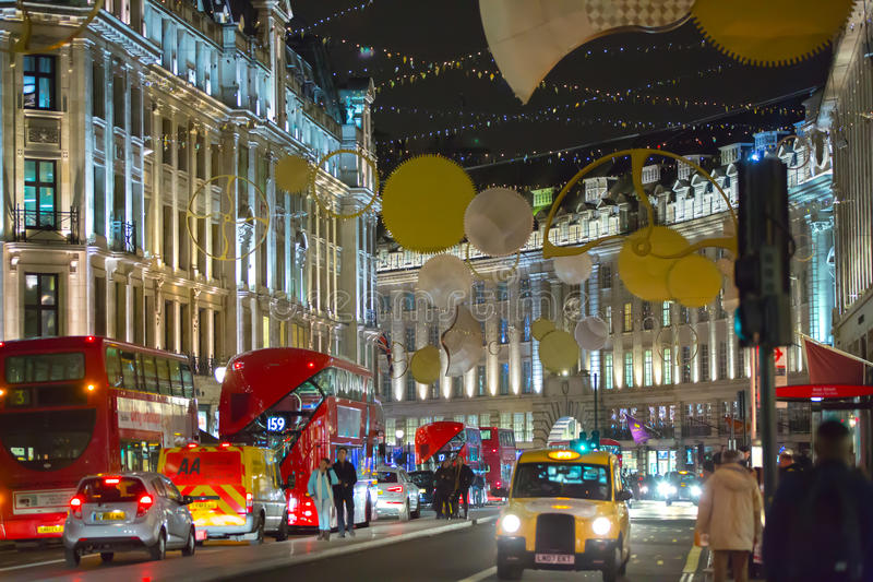 Christmas lights decoration at Regent street and lots of people. London. LONDON, UK - DECEMBER 30, 2015: Christmas lights decoration at Regent street and lots of royalty free stock photos
