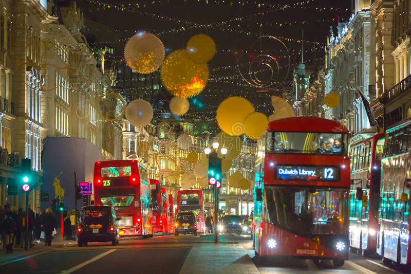 Christmas lights decoration at Regent street and lots of people. London. LONDON, UK - DECEMBER 30, 2015: Christmas lights decoration at Regent street and lots of stock images