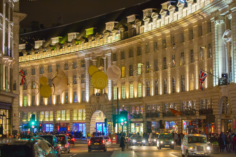 Christmas lights decoration at Regent street and lots of people. London. LONDON, UK - DECEMBER 30, 2015: Christmas lights decoration at Regent street and lots of royalty free stock photography