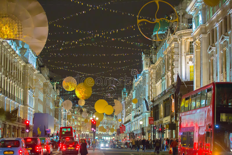 Christmas lights decoration at Regent street and lots of people. London. LONDON, UK - DECEMBER 30, 2015: Christmas lights decoration at Regent street and lots of royalty free stock photo