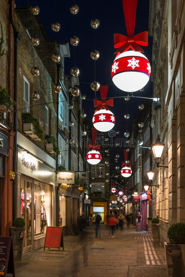 Christmas Lights decorations in central London, UK. LONDON - DECEMBER 21st 2014: St Christopher's Place Christmas Lights, a popular destination for West End stock photography