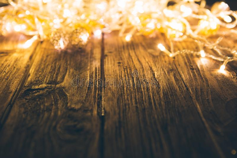 Christmas lights with empty wooden table. Christmas or New Year concept royalty free stock photos