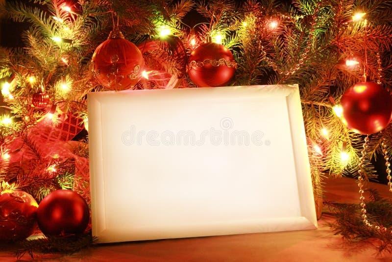 Christmas lights frame. Colorful abstract background with christmas lights and white frame. Christmas background with Ribbon boll and ornaments