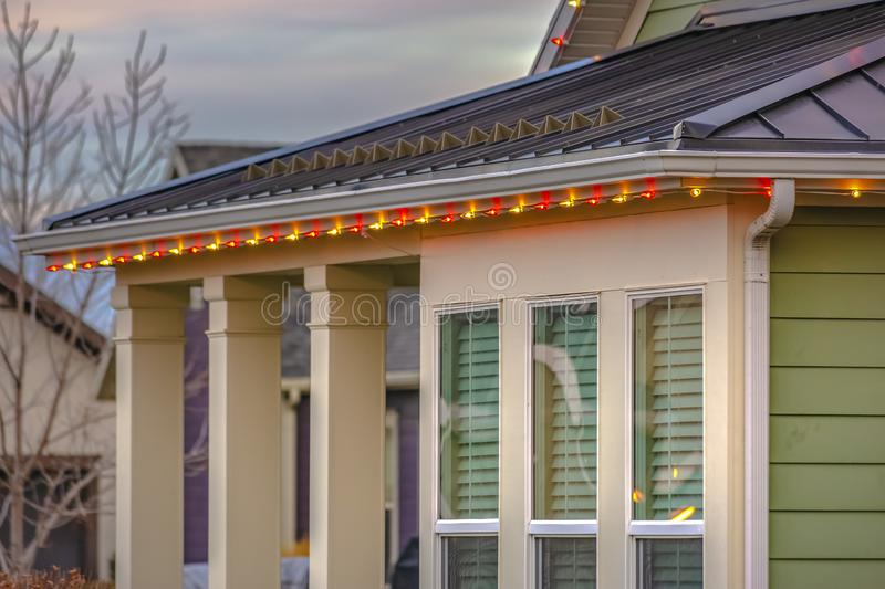 Christmas lights framing the roof of home in Utah royalty free stock photo