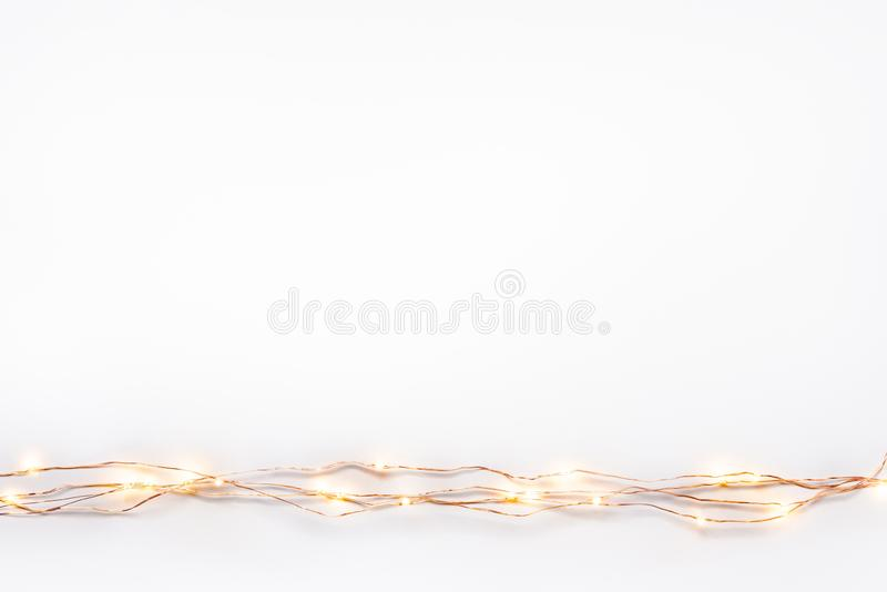 Christmas lights garland border over white background. Flat lay, copy space. Christmas lights garland border over white background. Flat lay, copy space vector illustration