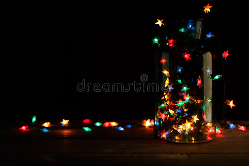 Christmas Lights In Glass Jar On Wood Holiday Background
