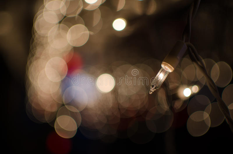 Christmas Lights Glimmering. Christmas lights, on in focus and the rest glowing bokeh blur stock image
