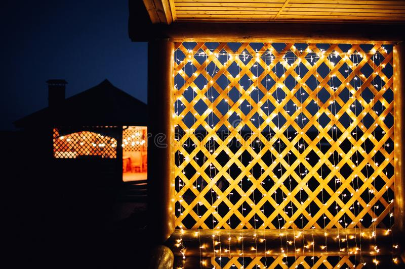Christmas lights on house background texture in city royalty free stock photography