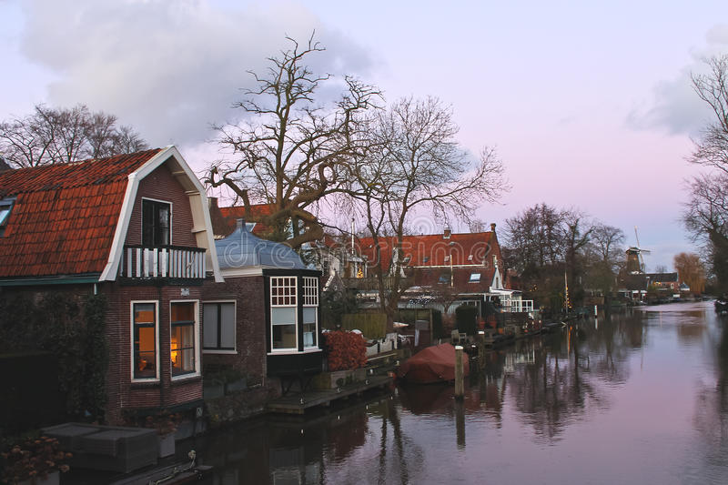 Christmas lights in houses on a river in Dutch town Loenen. royalty free stock images