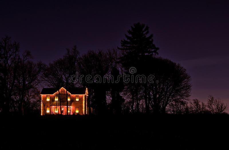 Download Christmas Lights On A Lone Rural Farmhouse Stock Photo - Image: 28344928