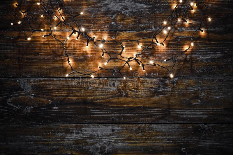 Download Christmas Lights On Wooden Background Stock Photo