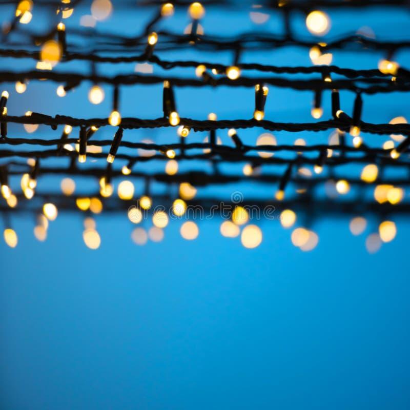 Christmas lights over blue night sky. Christmas blur lights over blue night sky can be used for holiday background royalty free stock photo